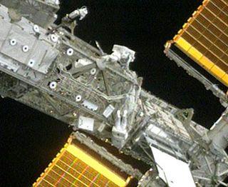 Astronauts Finish Long, Tough Spacewalk at Station
