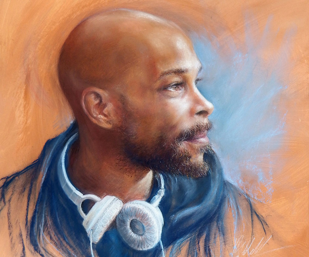 Pastel portrait of a man with headphones around his neck
