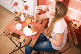 Teen girl eating breakfast,