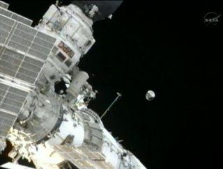 russian spacewalk sphere satellite release