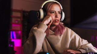 A frustrated looking girl playing a video game