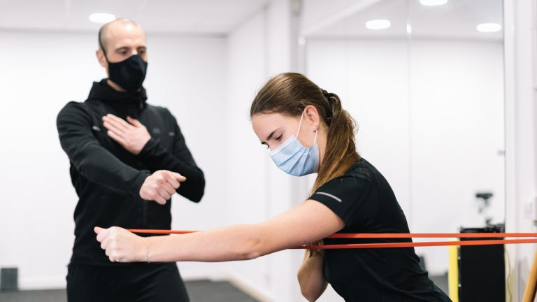 Man and woman training with face masks