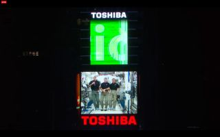 Astronauts on the International Space Station wish Earth a Happy New Year for 2014 in a video message shown in New York City's Times Square during the New Year's Eve bash on Dec. 31, 2013. From left, they are: Rick Mastracchio and Mike Hopkins, both of N