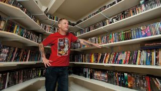 Corey Taylor with shelves and shelves of geeky stuff