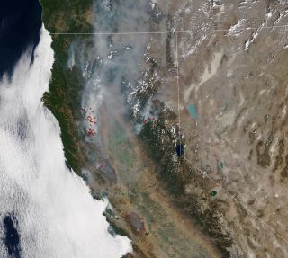 "The Moderate Resolution Imaging Spectroradiometer instrument on NASA's Terra satellite captured this view of California wildfires on Aug. 26, 2020. Red marks depict ""fire detections,"" or pixels in which the sensor and a computer algorithm indicated there was active fire."