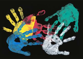 painted handprints on black background