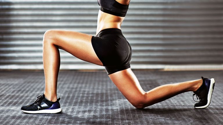 30-day legs challenge: woman with strong, toned legs doing a lunge exercise