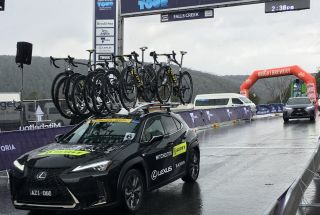 Defending champion Lucy Kennedy's Mitchelton-Scott team car heads down the descent of Falls Creek to the new start at the bottom of the climb