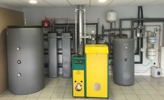 hot water storage units from Begetube. Begetube's two phase change material units (each contain 60 litres of hydrate salt) provide the same level of thermal storage as the 600 litre thermal store next to them