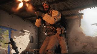 A Warzone operator fires his gun at off-screen enemies.