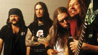 Pantera backstage with Dimebag Darrell mugging for the camera