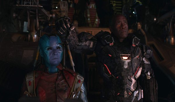 Avengers: Endgame Nebula and Rhodey look up with stern expressions