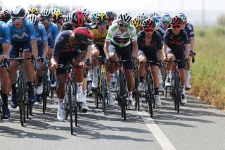 ALBACETE SPAIN AUGUST 18 LR Jhonnatan Narvaez Prado of Ecuador helps his teammate Egan Arley Bernal Gomez of Colombia and Team INEOS Grenadiers White Best Young Rider Jersey in final kilometres during the 76th Tour of Spain 2021 Stage 5 a 1844km stage from Tarancn to Albacete lavuelta LaVuelta21 on August 18 2021 in Albacete Spain Photo by Gonzalo Arroyo MorenoGetty Images