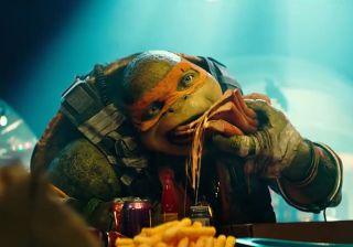 Michelangelo tucks into his favourite food, pizza