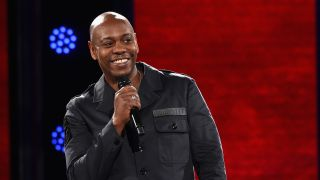 Dave Chappelle in a production still from his Netflix stand-up special 'Dave Chappelle: Sticks Stones'