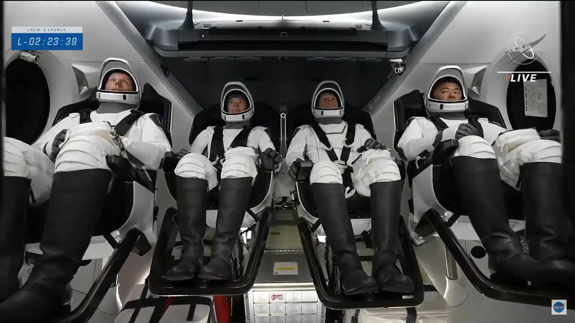 NASA's Crew-2 astronauts are seen aboard their SpaceX Crew Dragon Endeavour after boarding the craft for a launch to the International Space Station from Pad 39A of NASA's Kennedy Space Center in Cape Canaveral, Florida on April 23, 2021.