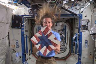 Astronaut Karen Nyberg Displays Quilt Block