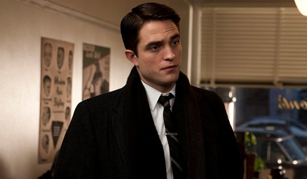 Life Robert Pattinson standing in a diner listening to someone