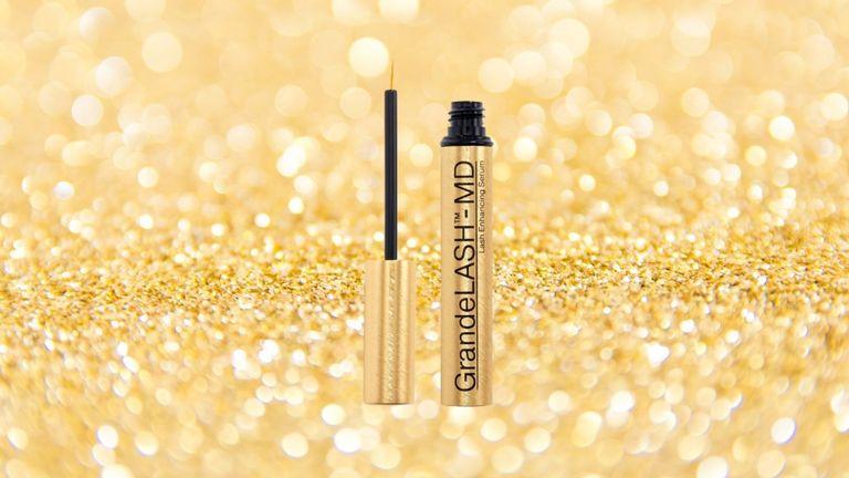 Grande Lash serum on a gold sparkly background