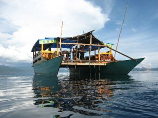 Locals built the sampling boat researchers used to test the waters of Lake Matano for the rare iron mineral known as green rust.