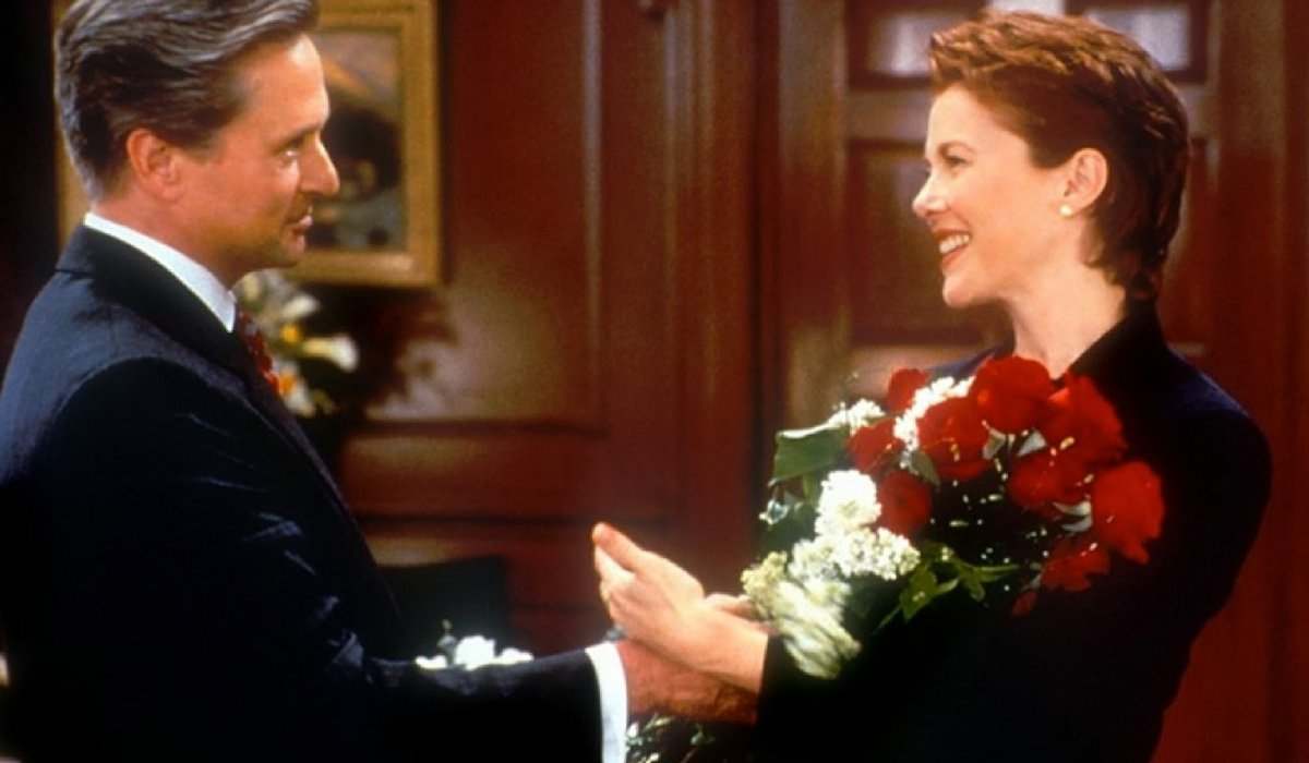The American President Michael Douglas gives flowers to Annette Bening