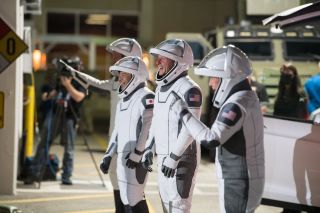 The Crew-2 astronauts smile as they bid farewell in a walkout dress rehearsal on April 18 for their launch on a SpaceX Crew Dragon and Falcon 9 rocket on April 22, 2021. From left to right they are: Thomas Pesquet of the European Space Agency, Akihiko Hoshide of the Japan Aerospace Exploration Agency and NASA astronauts Shane Kimbrough and Megan McArthur.