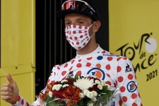 Team Israel Start Up Nations Michael Woods of Canada celebrates best climbers polka dot jersey on the podium at the end of the 14th stage of the 108th edition of the Tour de France cycling race 183 km between Carcassonne and Quillan on July 10 2021 Photo by Philippe LOPEZ AFP Photo by PHILIPPE LOPEZAFP via Getty Images