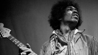 A photograph of Jimi Hendrix on stage