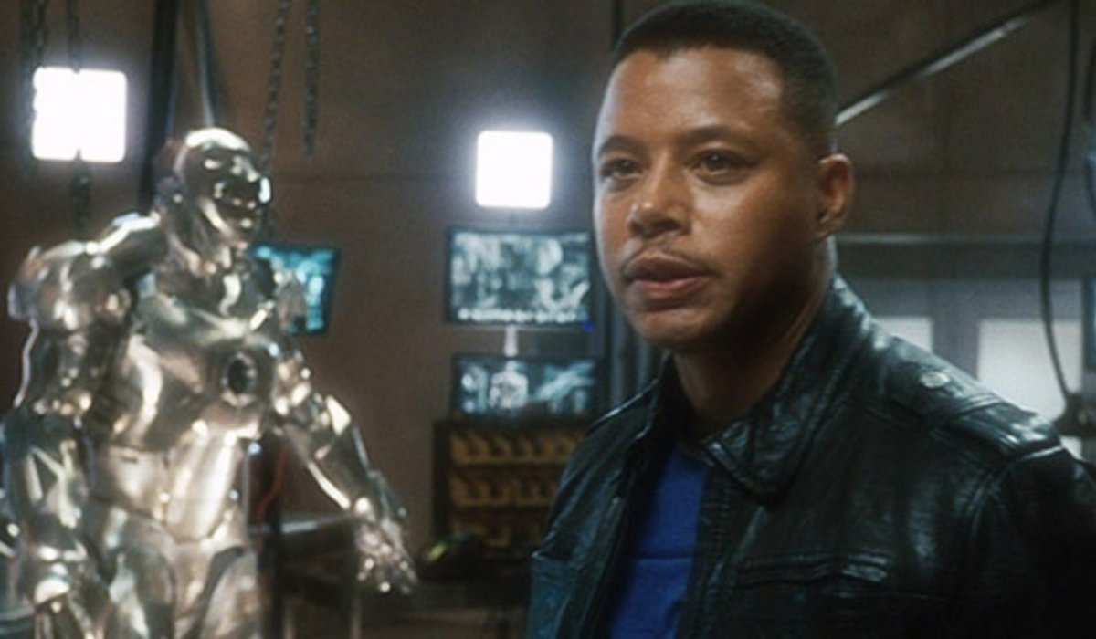Iron Man Terrence Howard, standing in front of some armor
