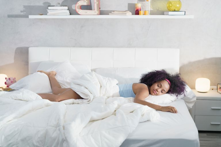 How to clean a mattress: Woman sleeping on mattress