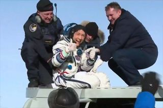 "NASA astronaut Christina Koch, newly back on Earth after a record 328 days in space, gives a ""thumbs up"" upon exiting the Soyuz MS-13 spacecraft on the Kazakh steppe on Feb. 6, 2020."