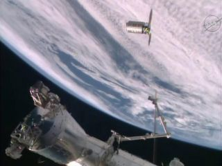 An unmanned Orbital ATK Cygnus spacecraft is seen at the International Space Station on Dec. 9, 2015 just before it is captured by the station's robotic arm. The spacecraft is carrying nearly 4 tons of supplies for the station's crew.