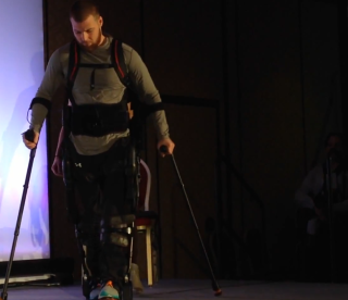 Shane Mosko demonstrates how a new device helps him to walk, at CES 2015.