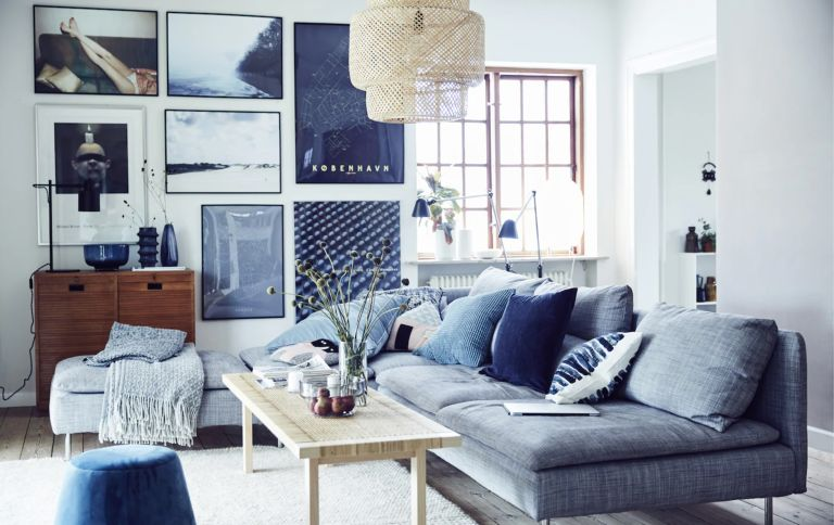 Small blue living room with gallery wall