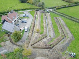 an aerial view of a ground source heat pump being installed