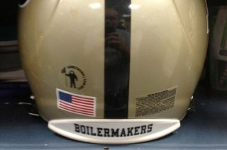 Snapshot of Purdue University Boilermakers' football helmet with decal paying tribute to the late astronaut Neil Armstrong.