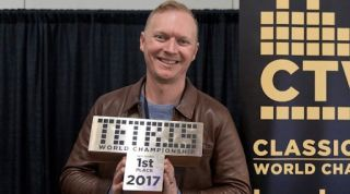 Jonas Neubauer holds his trophy from the 2017 Classic Tetris World Championship