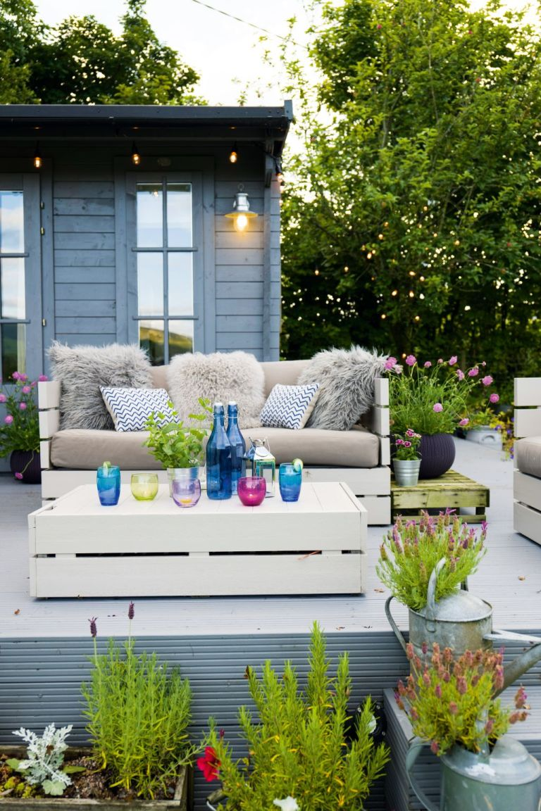 Garden with patio and watering can planters