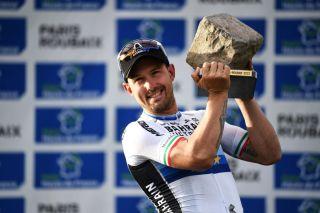 Sonny Colbrelli holds the trophy of Paris-Roubaix winner