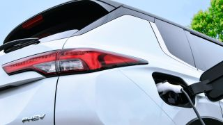 A close-up of the rear and charging port of the Mitsubishi Outlander PHEV