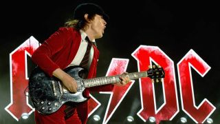 AC/DC band Angus Young playing live