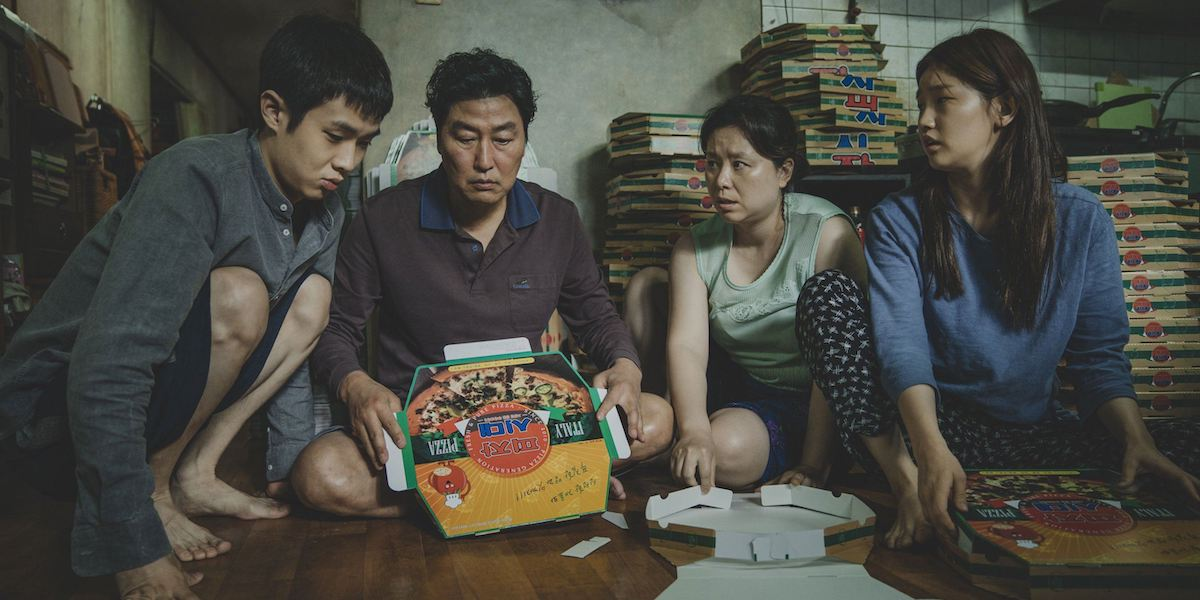 The Kim family folding boxes in Parasite