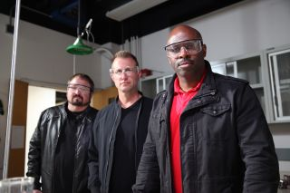 "From left to right: Author Mike Bara, former FBI agent Chad Jenkins, and retired NASA astronaut Leland Melvin debunk Apollo conspiracies in the new Science Channel show ""Truth Behind the Moon Landing."""