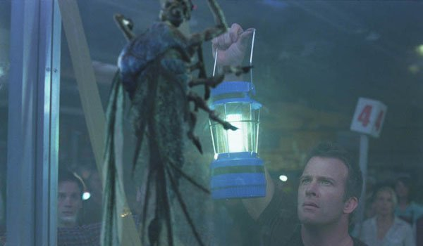 The Mist Thomas Jane holds a lantern to one of the bugs outside the store