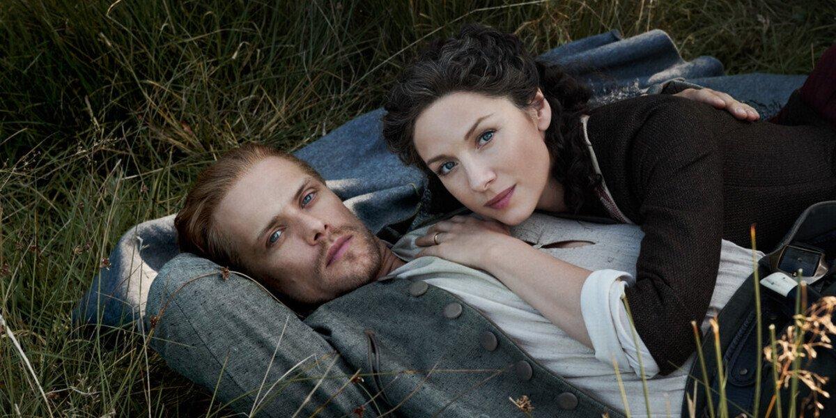 outlander season 5 jamie claire lying in grass starz