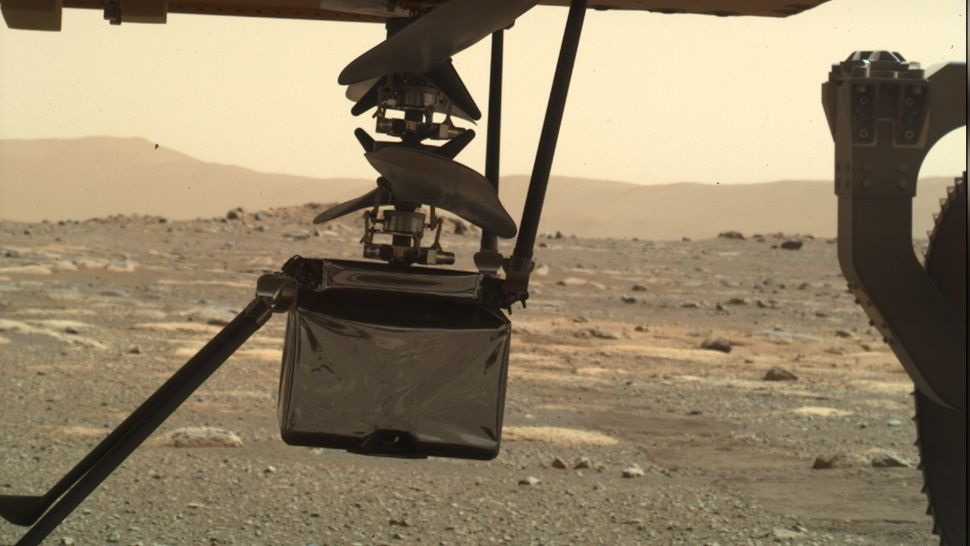 NASA's Mars helicopter is slowly unfolding beneath the Perseverance rover
