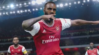 pes efootball 2022 release date arsenal player celebrating a goal