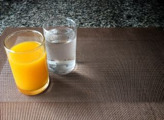 Glasses of orange juice and water.