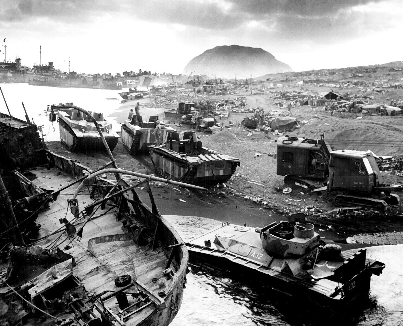 Smashed by Japanese mortar and shellfire, trapped by Iwo's treacherous black-ash sands, amtracs and other vehicles of war lay knocked out on the black sands of the volcanic fortress. c. February/March 1945