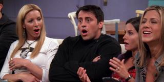 Friends Phoebe, Joey and Monica shocked, Rachel smiling